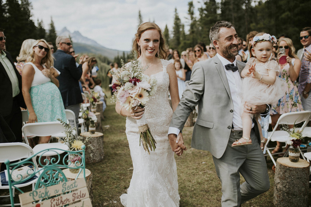 married couple walks down isle mt norquay weddding banff