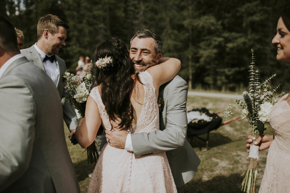 groom hugs bridesmaid mt norquay wedding