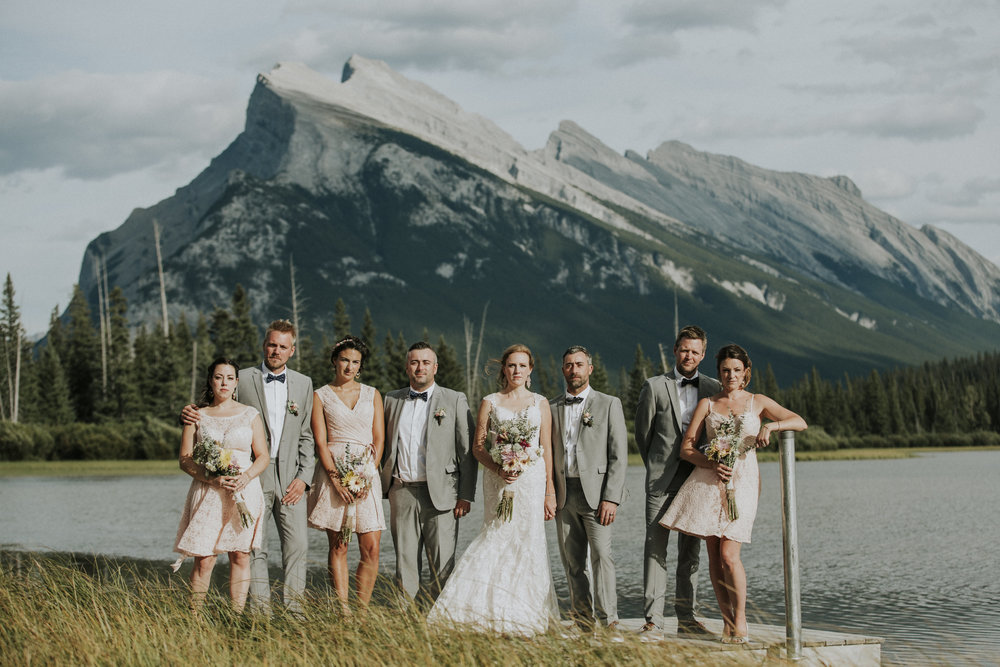bridal party smiles at banff mountain wedding