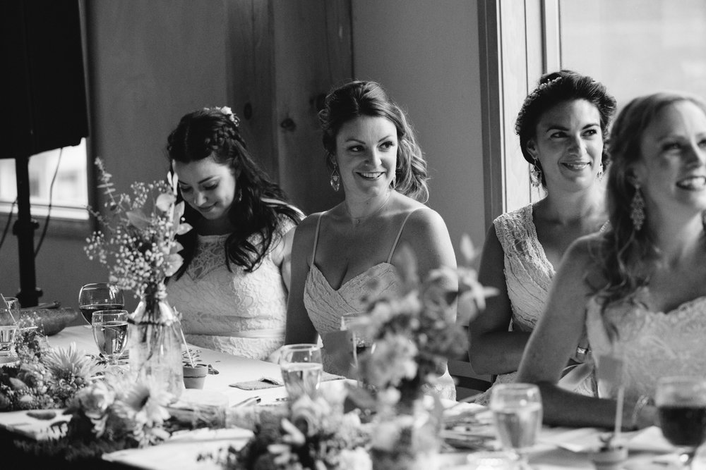 bridesmaids smile at speeches mt norquay wedding reception banff