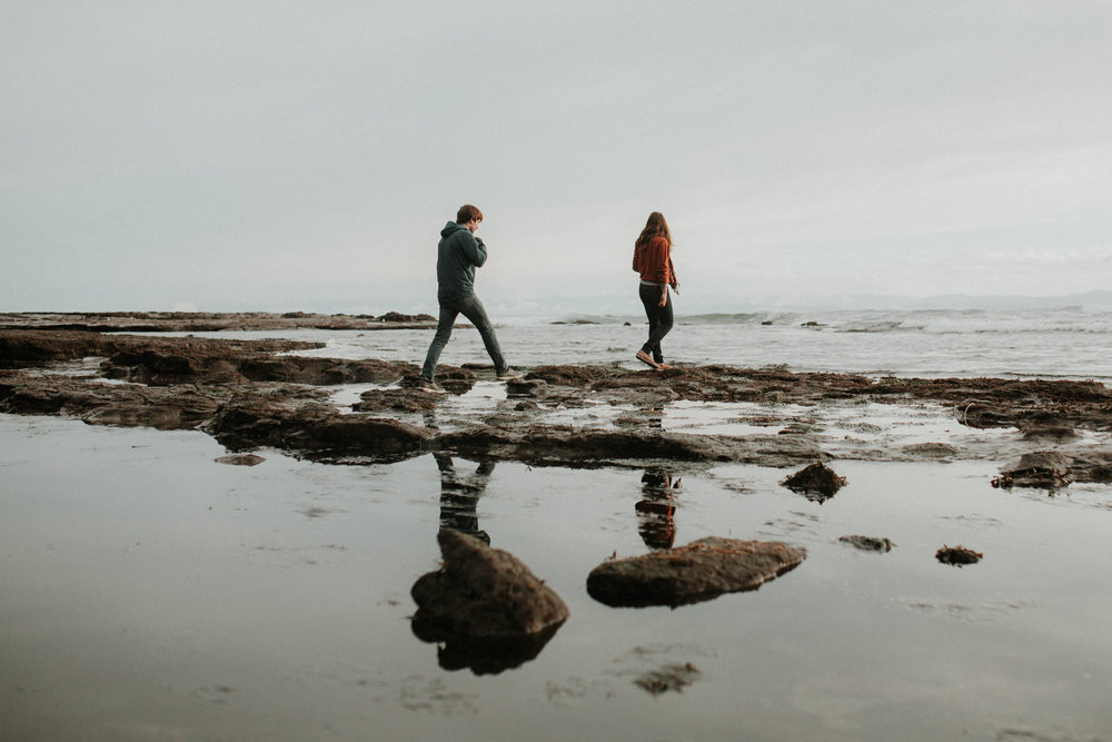 Couple walk Botanical Beach, Juan de Fuca, Vancouver Island Engagement