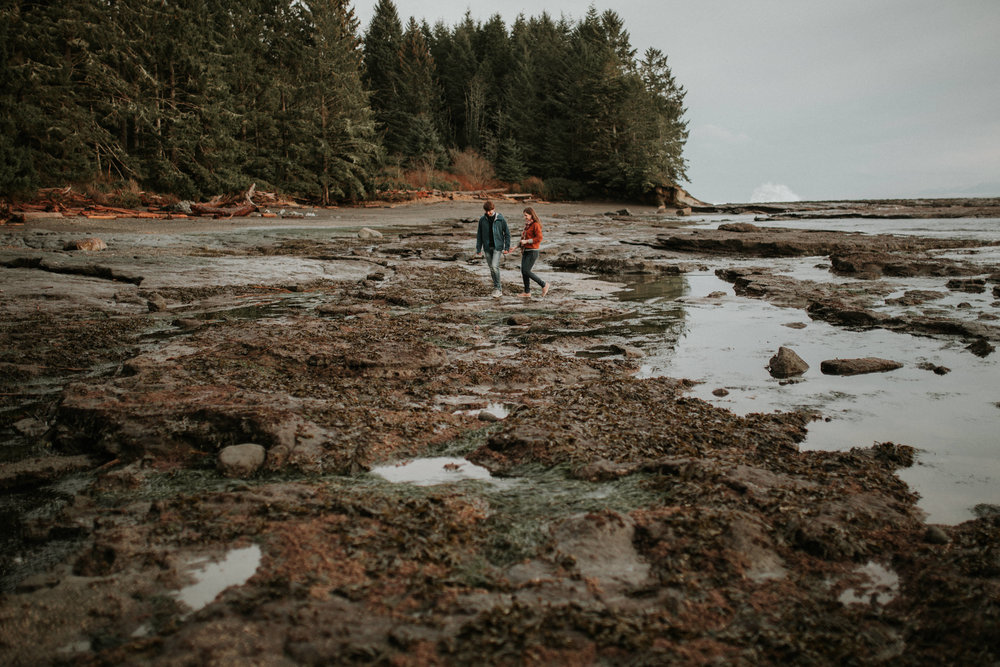 Couple strolling in the shoreline Beach Engagement Botanical Beach Juan de Fuca