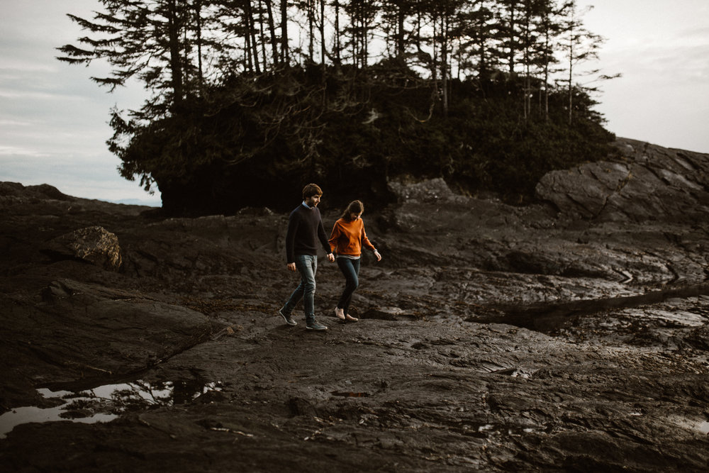 Couple walks Botanical Beach, Juan de Fuca, Vancouver Island engagement
