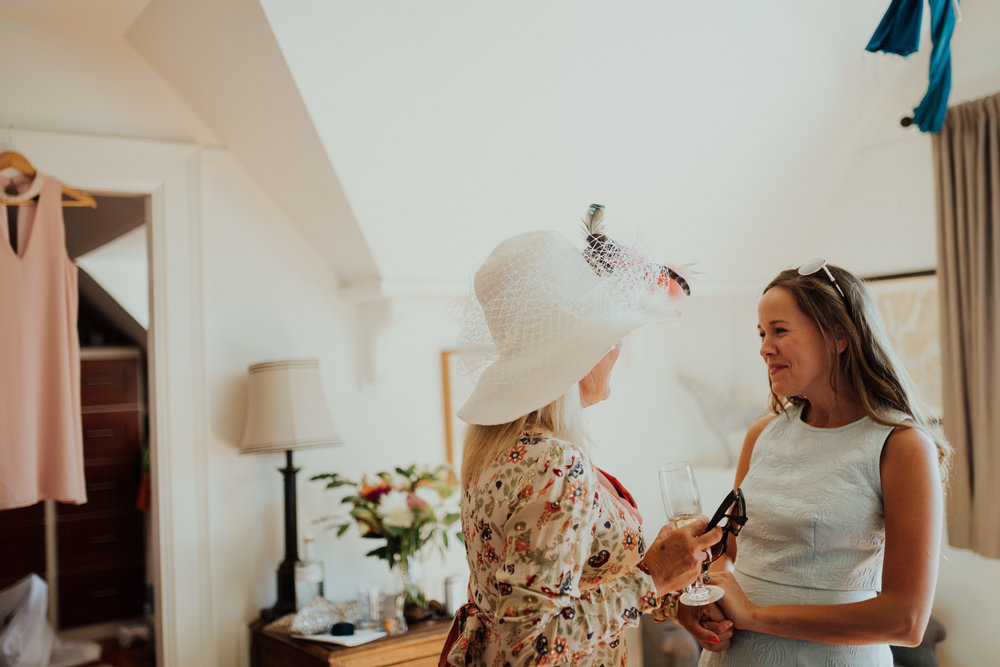 mother of the bride with friend getting ready