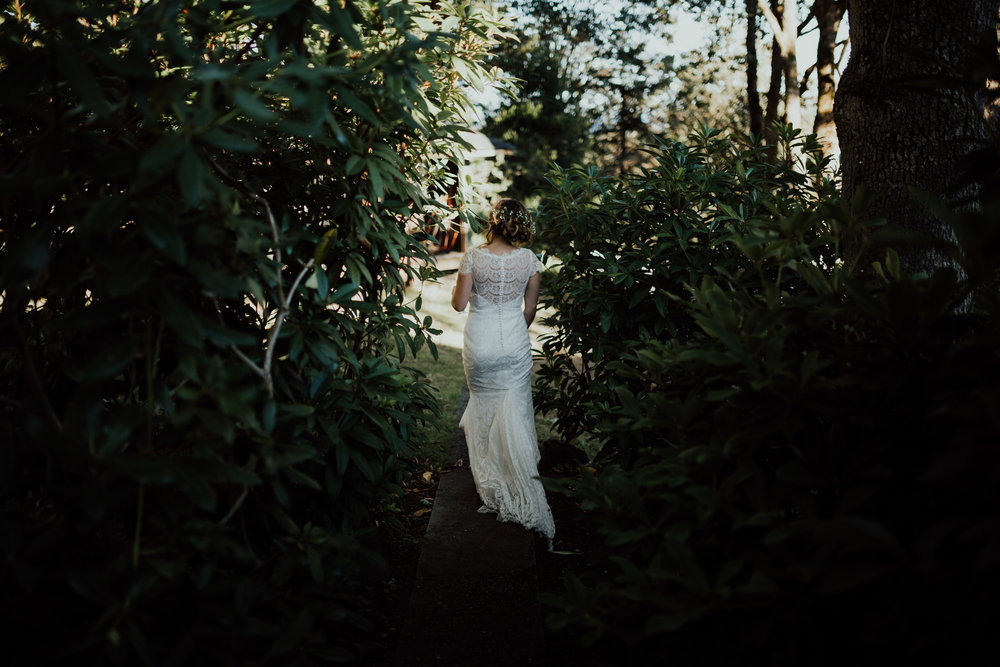 bride walks through woods backyard wedding, Victoria, Vancouver Island