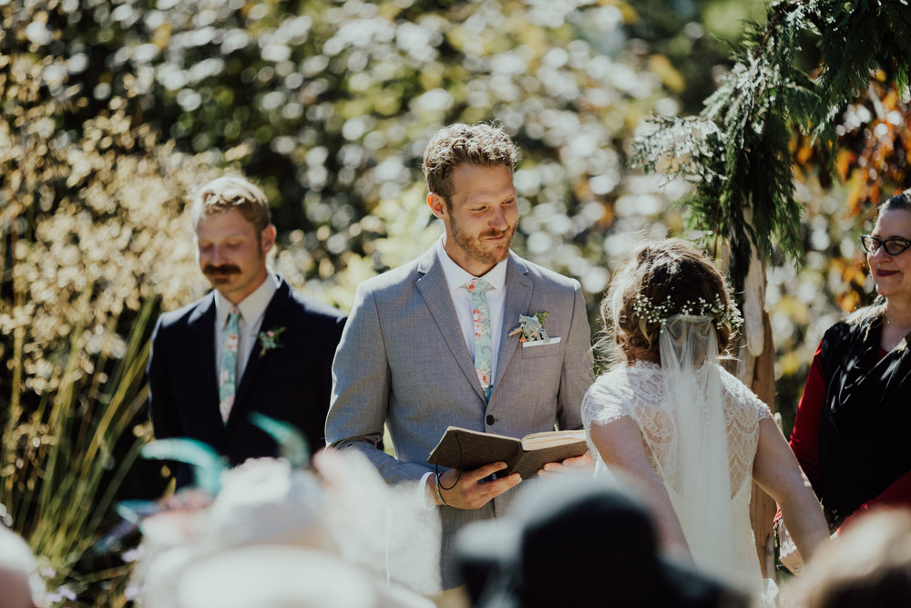 groom reads vows to bride at backyard wedding, Victoria, Vancouver Island wedding