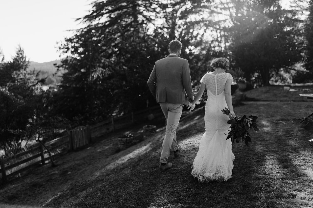 bride and groom walk to reception backyard wedding, Victoria, Vancouver Island wedding