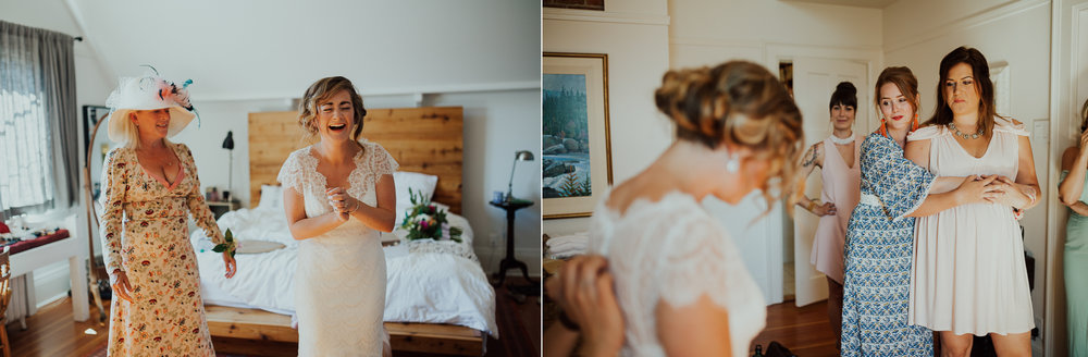 bride laughs with bridesmaids while getting ready for wedding