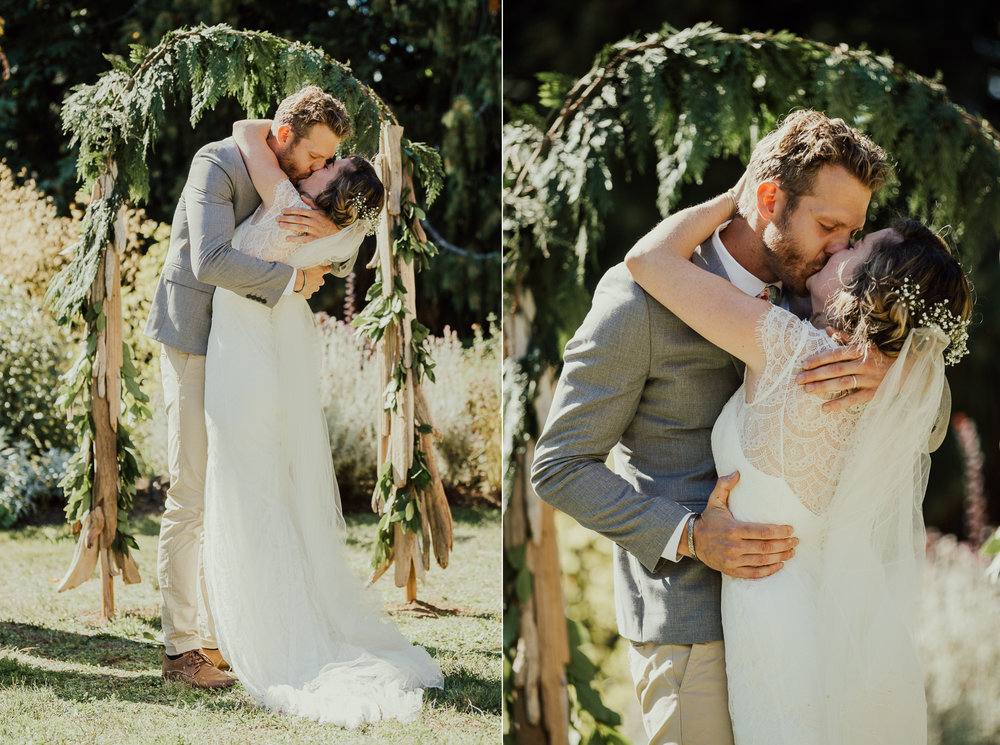 bride and groom have first kiss backyard wedding victoria