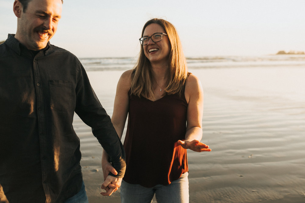 Couple laughing and having fun on Long Beach, Tofino for their engagement session.