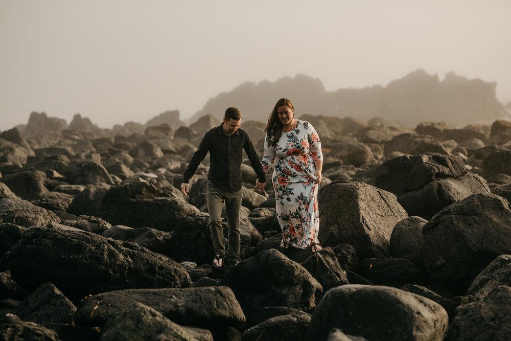 Couple climbs the rock on Big Beach in Ucluelet wedding photographer