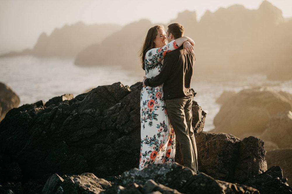 Engaged couple hugs Big Beach, Ucluelet wedding photographer