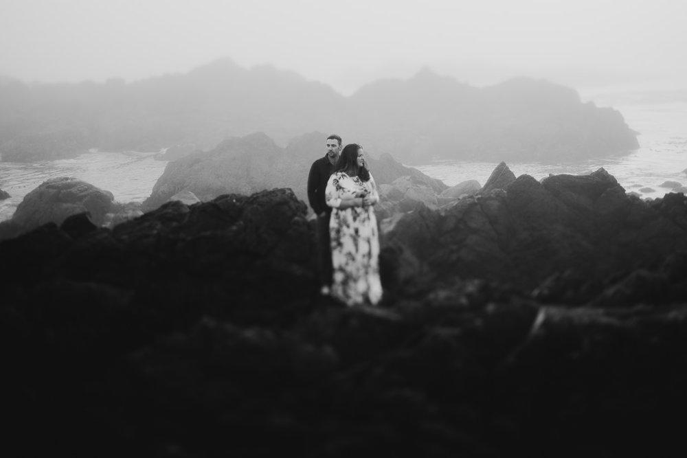 Engaged couple on cliffs Ucluelet wedding photographer