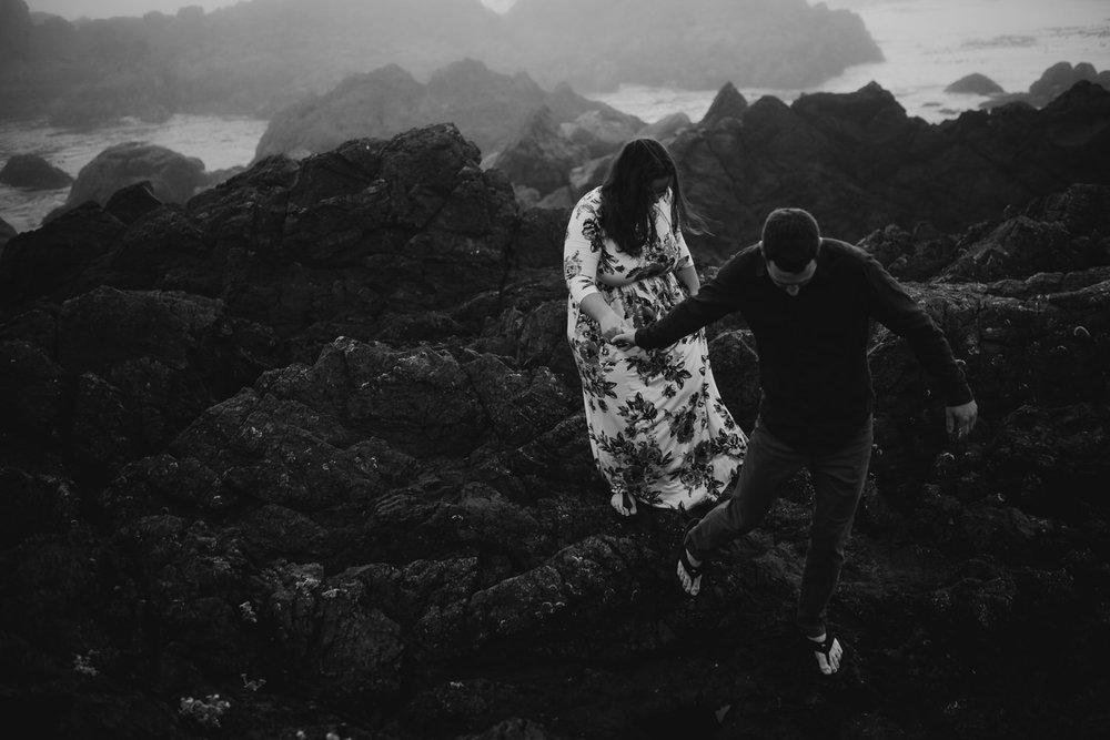 Couple holds hands on the cliffs in Ucluelet wedding photographer
