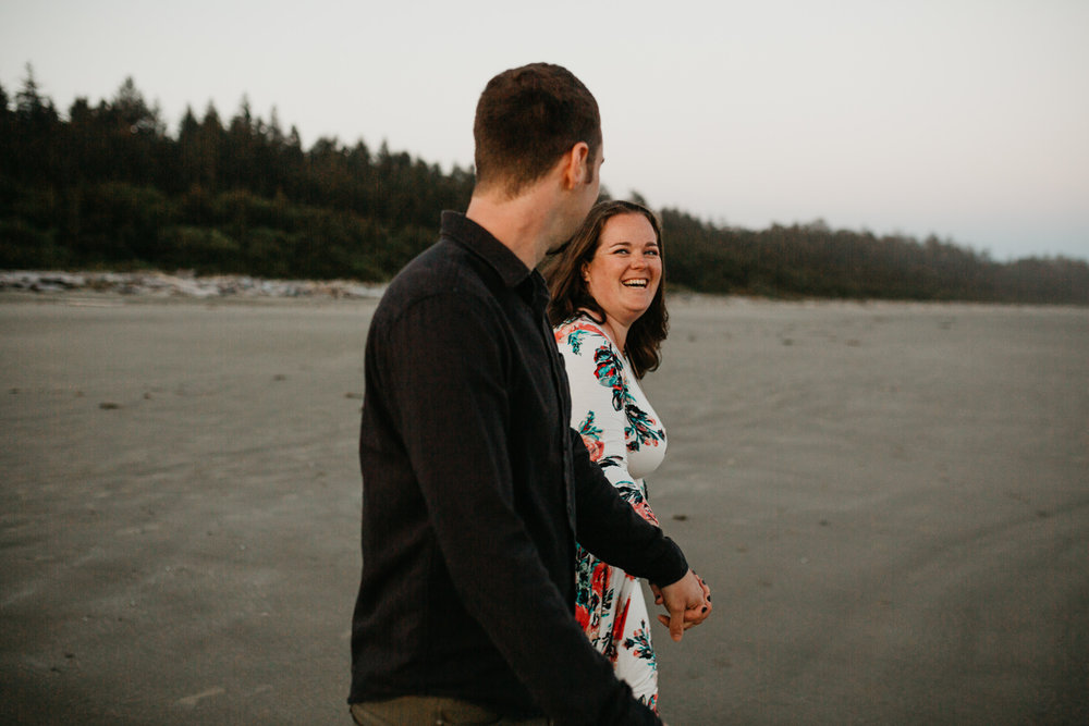 engaged couple holds hand Long Beach, Tofino wedding photographer
