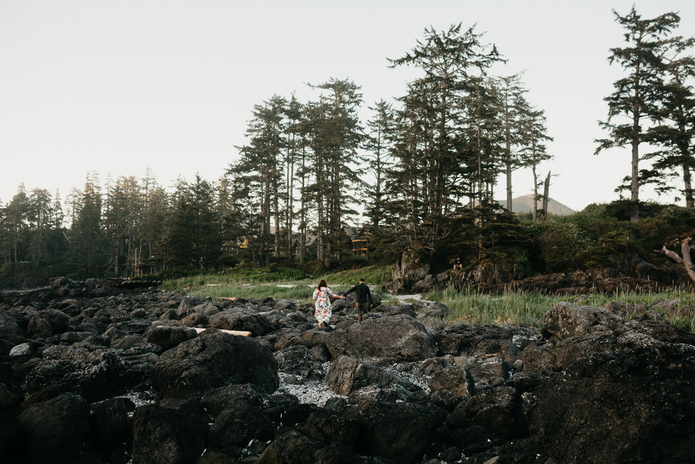 Couple walks holding hands on Big Beach in Ucluelet, BC wedding photographer