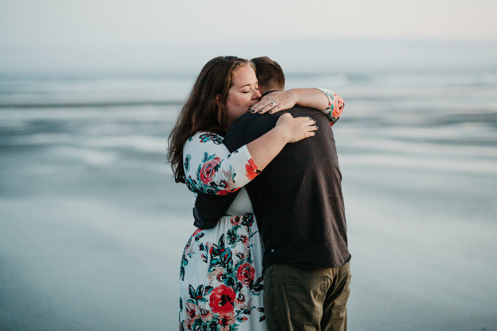 Couple hugs on the beach Long Beach, Tofino wedding photographer