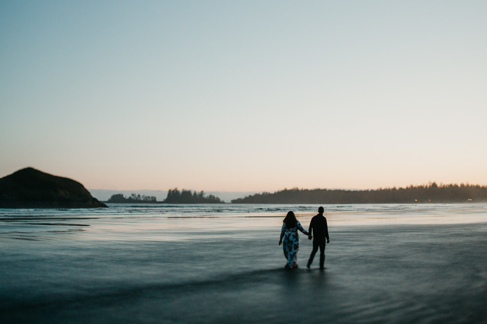 Couple walks along the beach after sunset on Long Beach, Tofino wedding photographer