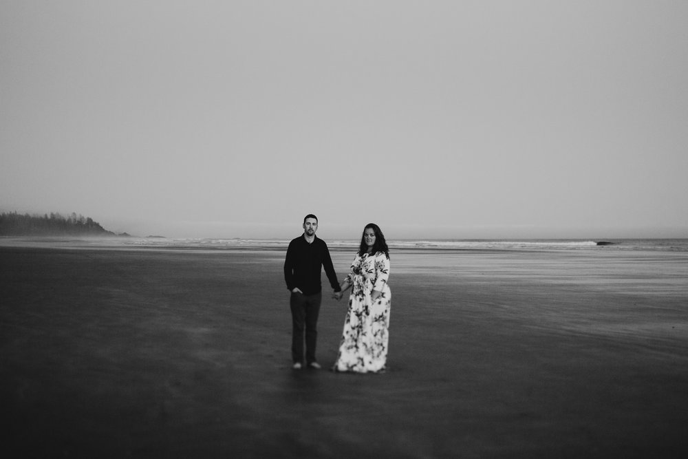 Couple stands on beach after sunset on Long Beach, Tofino wedding photographer