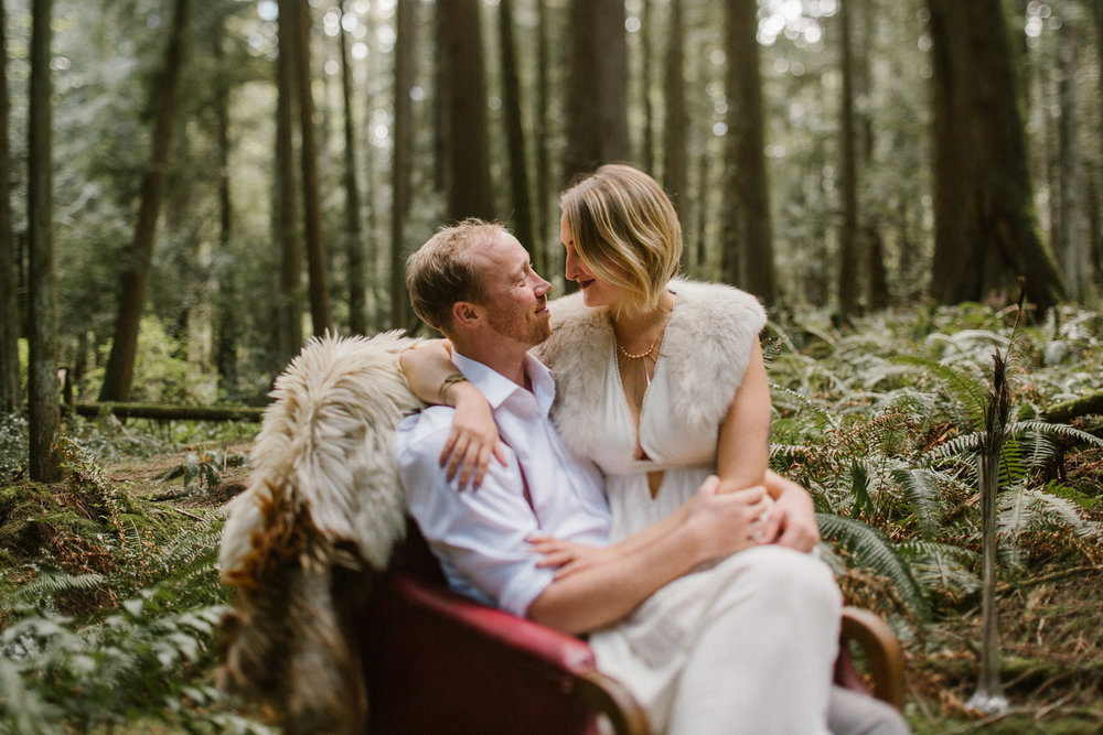 Couple embracing in the woods, Vancouver Island Engagement Photographer