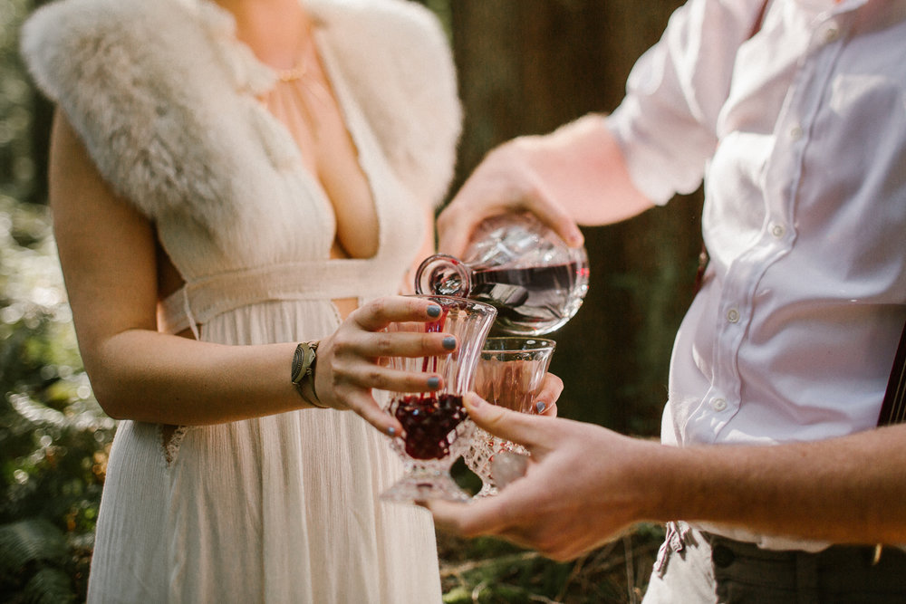 Couple drinking wine, forest engagement session in Victoria, BC