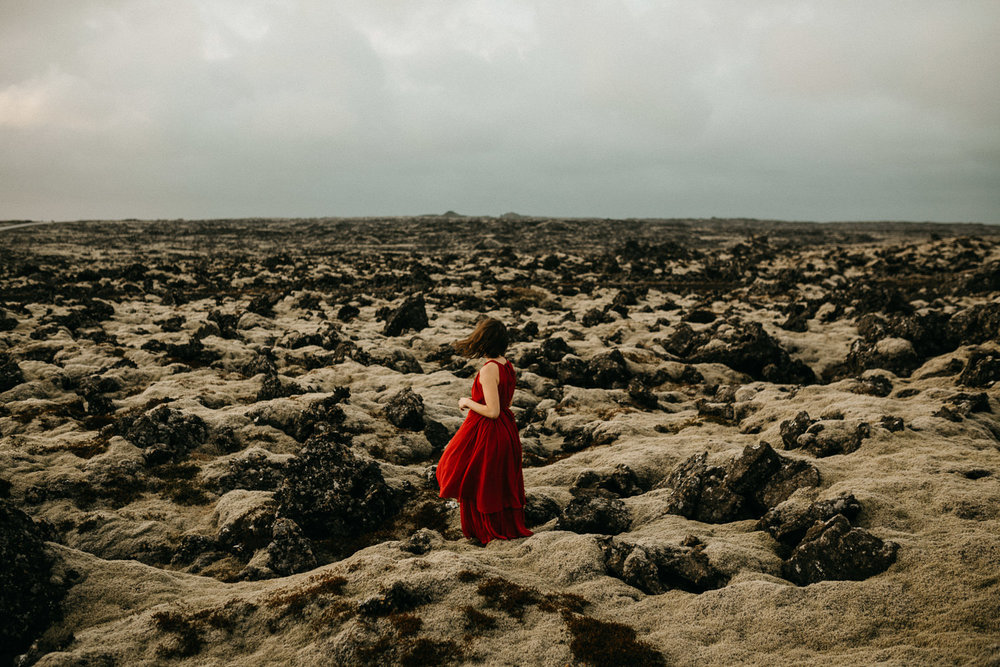 woman in red dress at lava fields