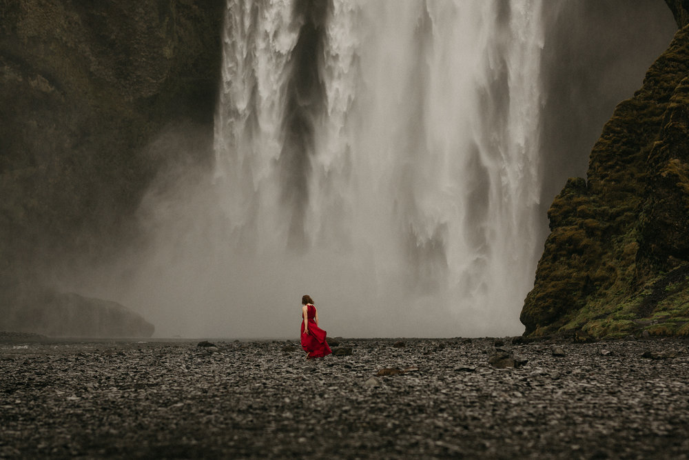 woman in red dress Seljalandsfoss iceland