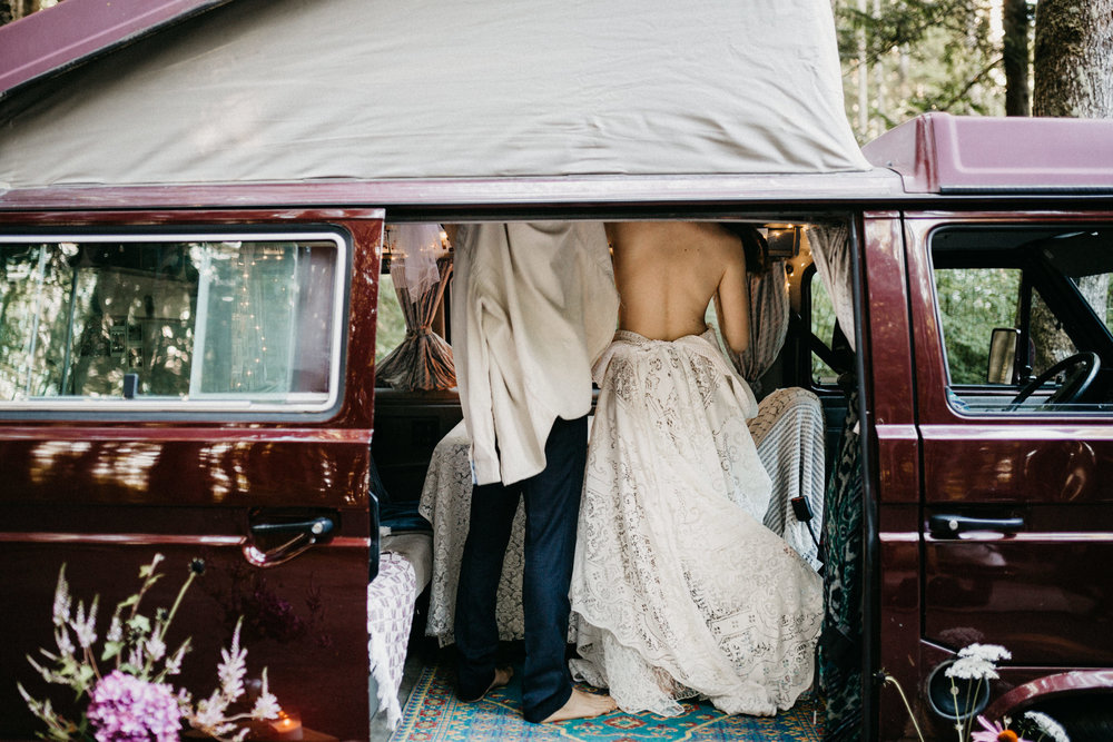 Bride and Groom get dressed in a VW Westie Elopement Sombrio Beach Vancouver Island