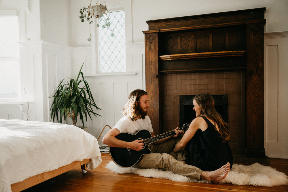 a man play guitar for his wife at home Victoria wedding photographer