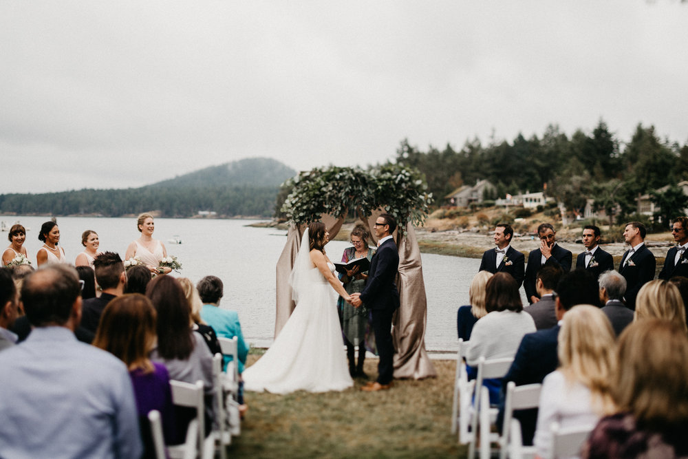 Bride and Groom holding each other Galiano Inn Beach Wedding Ceremony