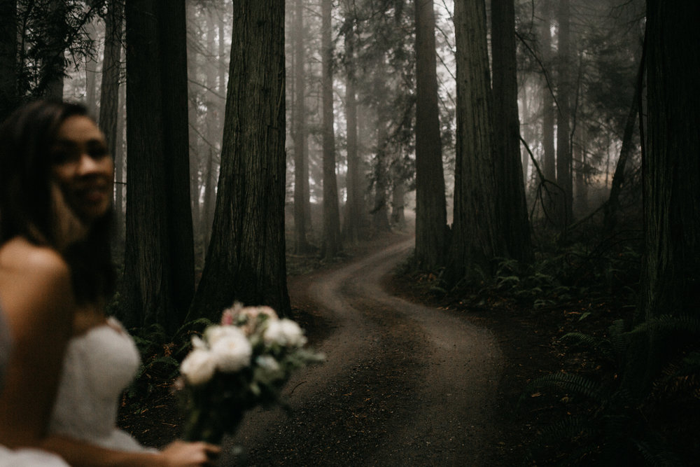 The Bride in a Foggy forest pathway Galiano Island Wedding