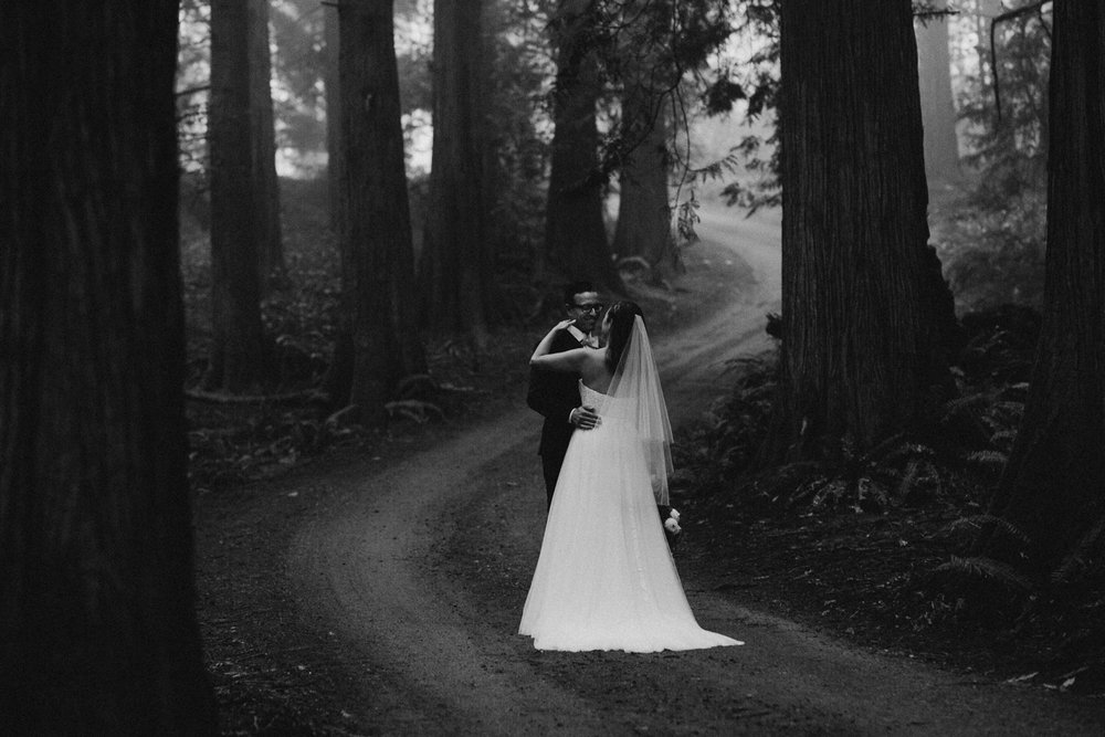 Bride and Groom Kissing in Forest pathway Foggy Galiano Island Wedding