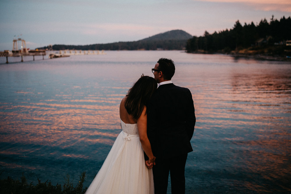 Newly wed Bride and Groom enjoying the sunset Galiano Inn Wedding