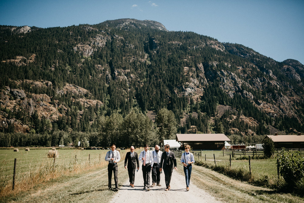 groomsmen walk down road Pemberton farm wedding