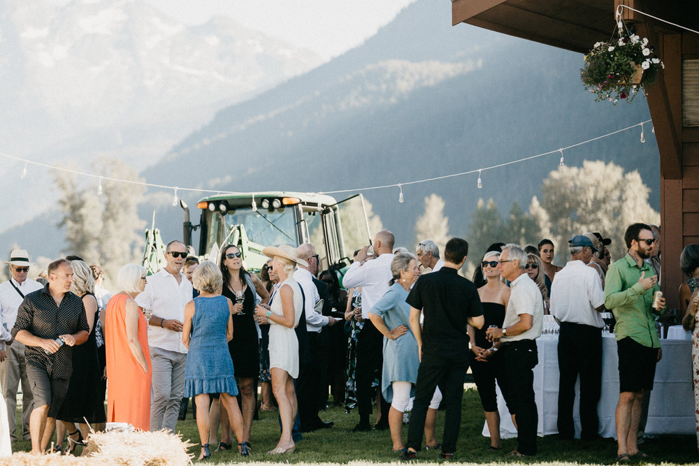 Guests enjoy drinks at Pemberton farm wedding