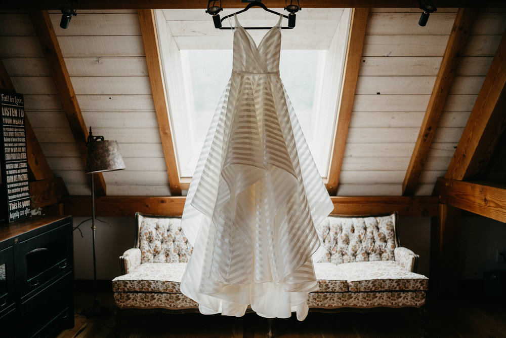 Wedding dress hanging at Bird's Eye Cove wedding, Vancouver Island
