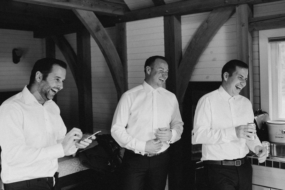 groomsmen laughing at Bird's Eye Cove wedding, Vancouver Island