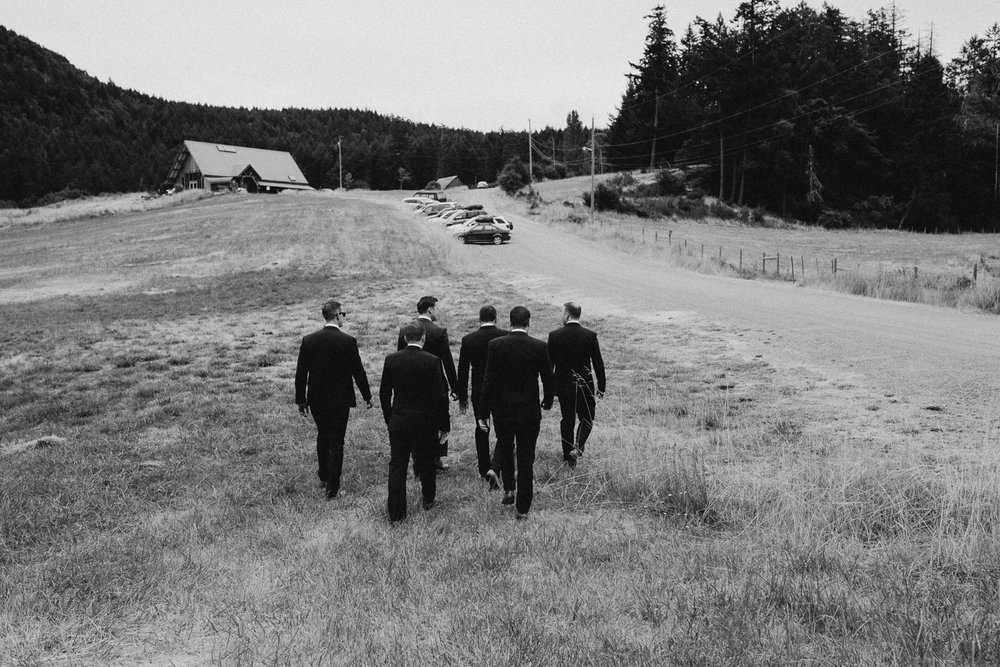 groomsmen walking to ceremony at Bird's Eye Cove wedding, Vancouver Island wedding photographer