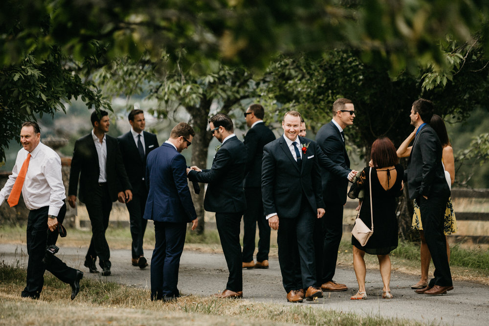 groom and guests at Bird's Eye Cove wedding, Vancouver Island wedding photographer
