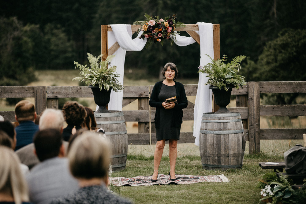 officiant at ceremony at Bird's Eye Cove wedding, Vancouver Island