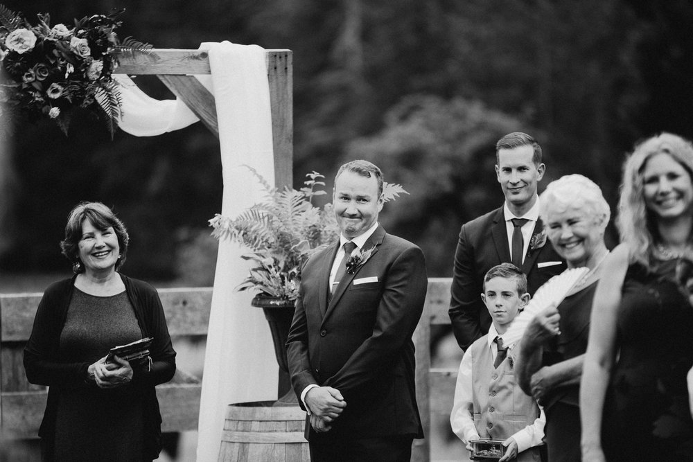 groom cries looking at bride at Bird's Eye Cove wedding, Vancouver Island