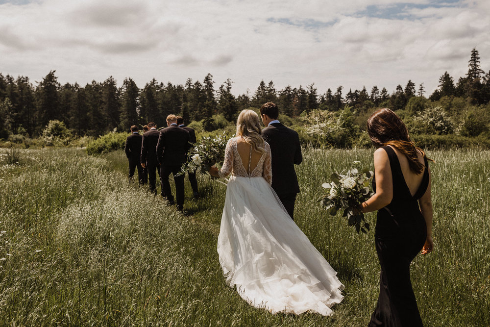 Bridal party walks through Elk Lake meadow, Victoria Wedding photographer