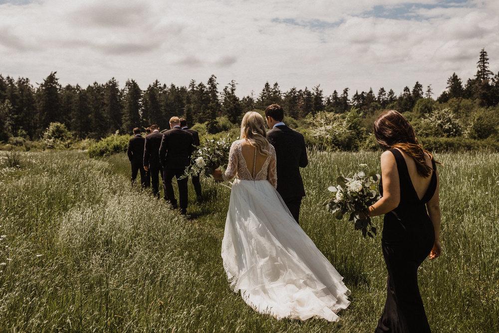 Bridal party walks through Elk Lake meadow, Victoria Wedding photographer