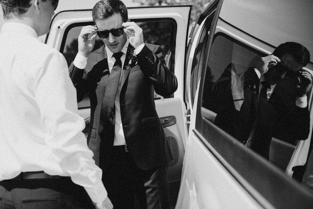 groom puts on sunglasses Victoria wedding photographer