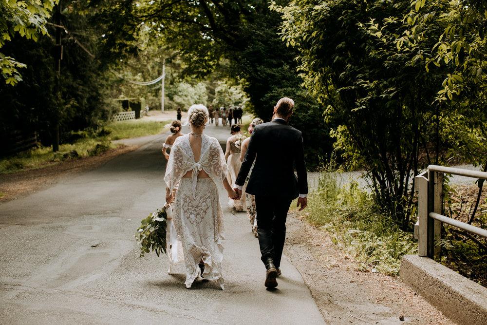 bride and groom walk to garden ceremony victoria wedding photographer