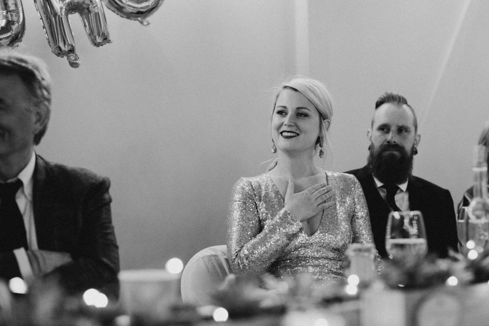 bride smiles during wedding speeches, victoria wedding photographer
