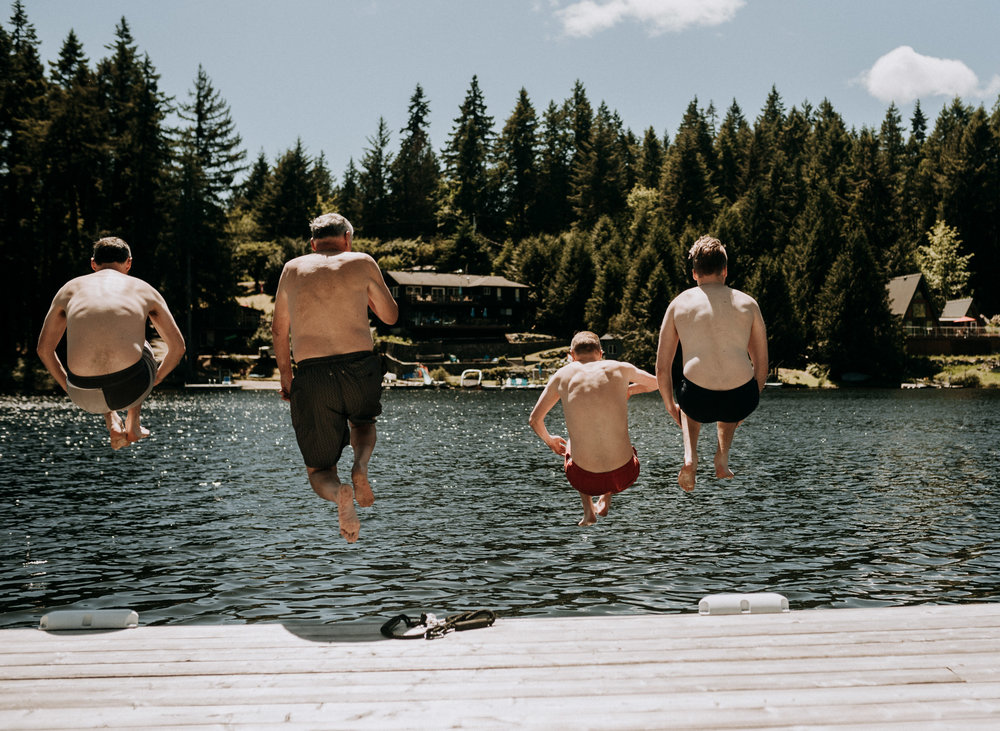 groomsmen jump into lake shawnigan lake, vancouver island wedding photographer