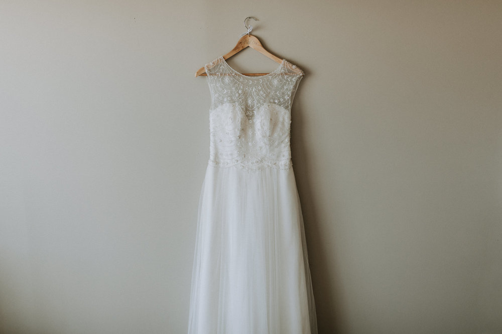 wedding dress on wall vancouver island wedding photographer