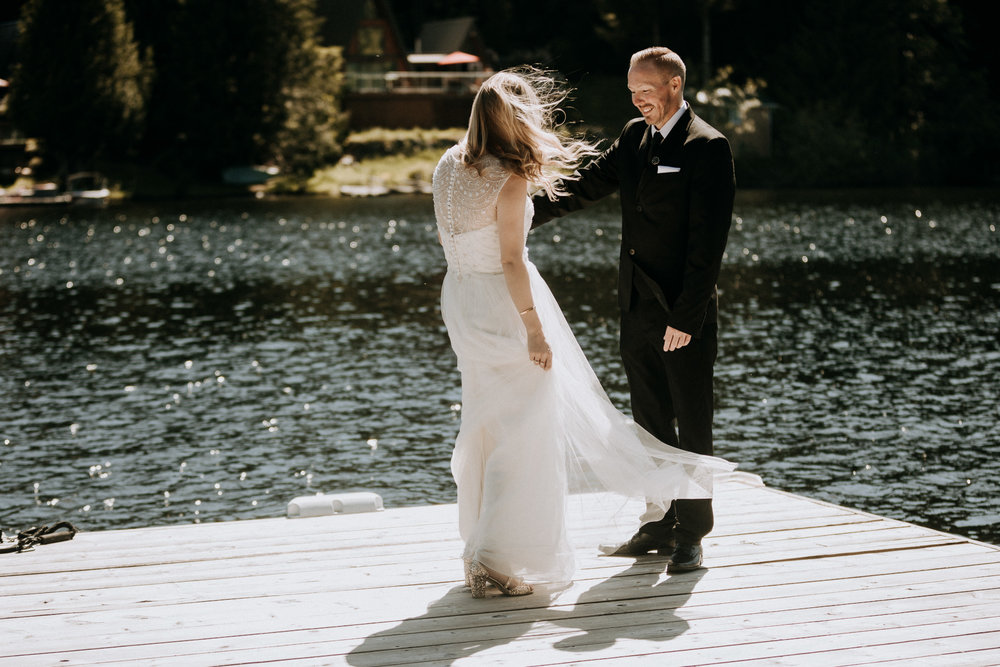 bride and grooms first look on dock vancouver island wedding photographer