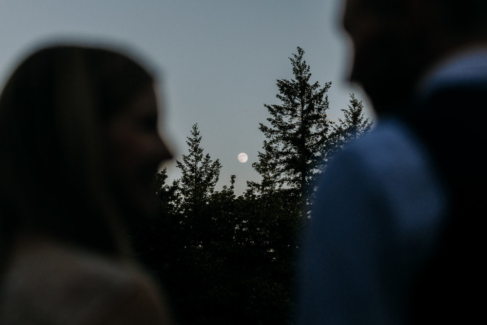 full moon rises behind bride and groom vancouver island wedding photographer